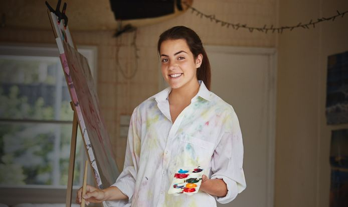 A young artist looking happy