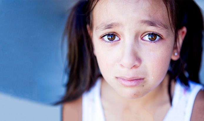 A kid looking sad