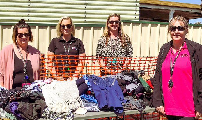 team organised a community event offering free food, clothes and resources.