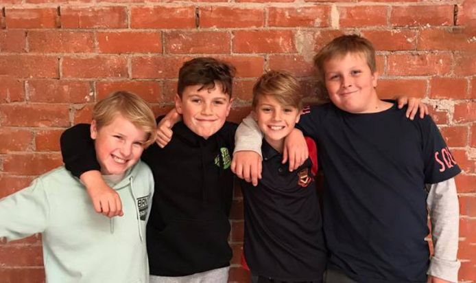 Group of boys looking happy