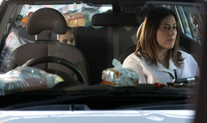 Homeless mother and daughter in their car
