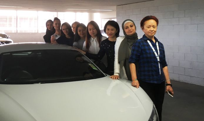 Women standing in front of an Audi