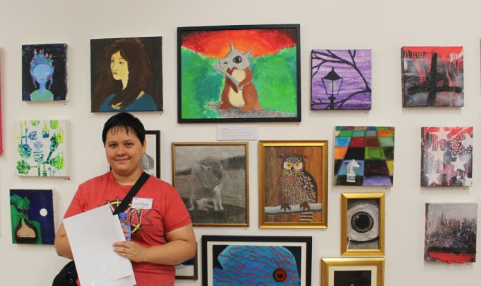 CYI student with artwork