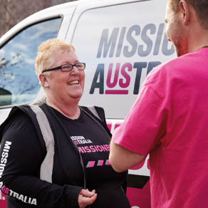 Mission Australia employees in a Missionbeat van