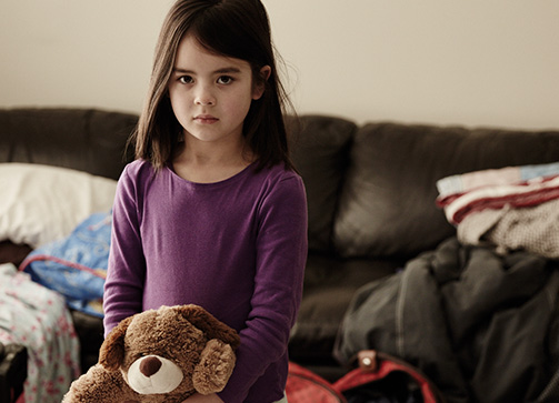 Little girl standing with her teddy bear