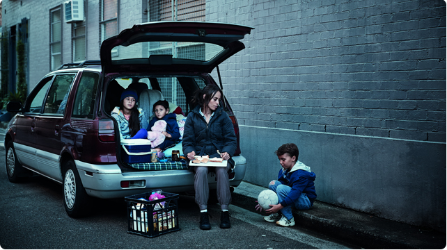 photo of homeless family in car