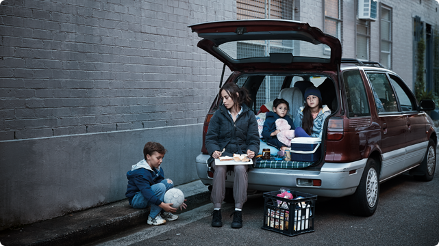 photo of family living in the car